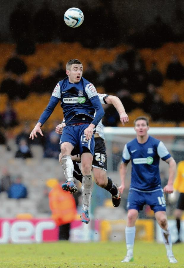 High rise - the impressive Matthew Lund clears the ball for Southend United