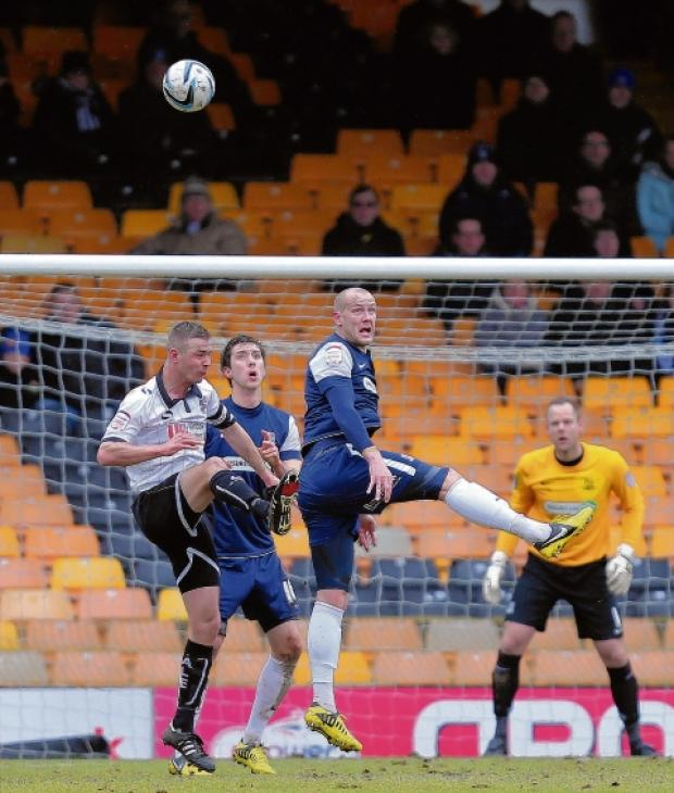 Ryan Cresswell heads clear for Southend United at Port Vale