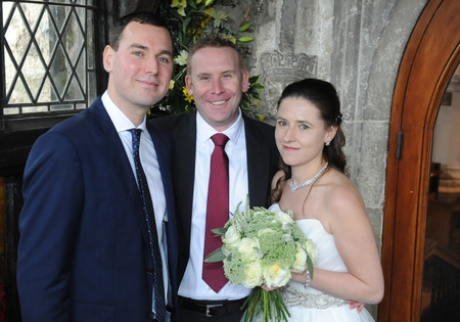 Jeremy Ray, centre, with newlyweds Karen and James Wiley