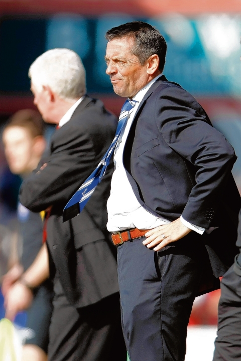Phil Brown - has released five players from the club