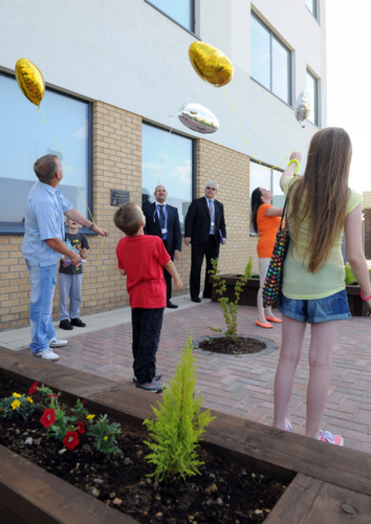 Balloons are released at the opening of the Brad Baldwin Memorial Garden