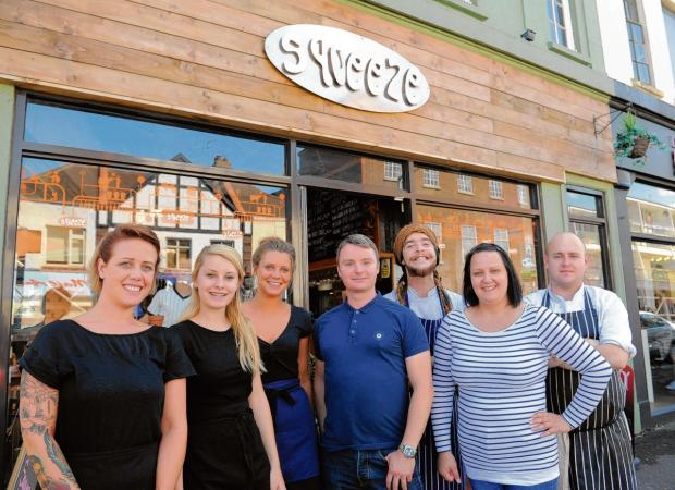 Team work – Rob Mears, centre, with Gerrie Walker and their staff outside the Squeeze cafe in Leigh
