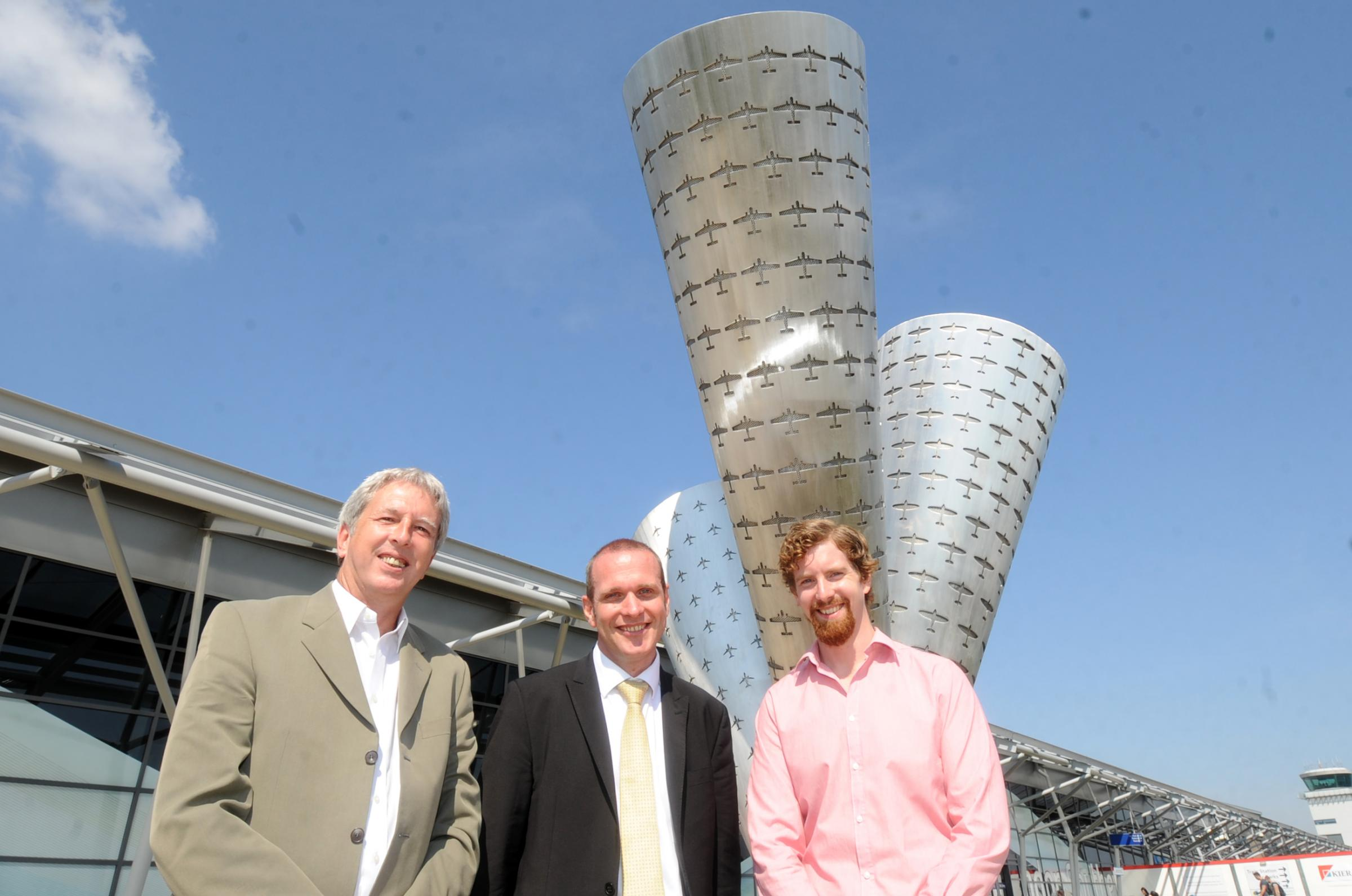 Airport director of operations David Lister, centre, with John Delaney and Tom Curtis