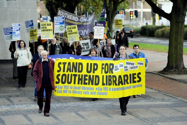 Campaigners protested against cuts to libraries and care homes before the meeting