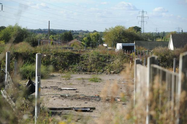 "Echo: Demolished pitches like this at Dale Farm are being used as business ""head offices"""