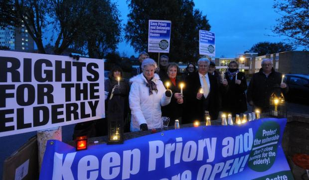 Echo: Campaigners hold a vigil outside Priory House