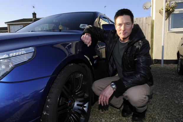 Motorist vows to fight for pothole damage