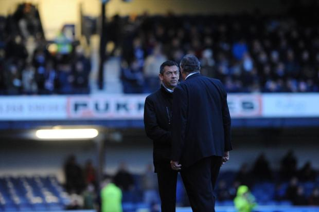 Southend United manager Phil Brown chats with stadium manager Dave Jobson during the floodlight failure