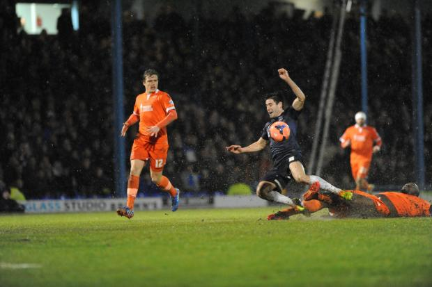 Michael Timlin charges forward for Southend United against Millwall