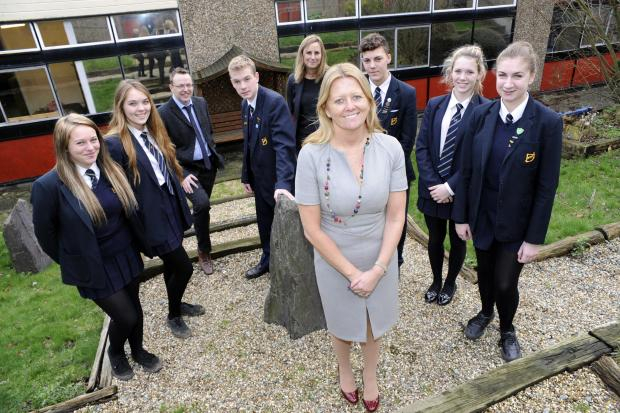 Headteacher Jan Atkinson (at front, centre) with Assistant heads Desi McKeown and Lisa Stroud with pupils Deanes School, Daws Heath Road, Thundersley