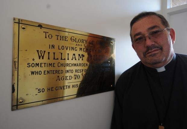 Echo: Pride of place – Rev Peter Mallinson with the plaque commemorating church warden William Budd. Picture taken by Echo photographer Steve O'Connell