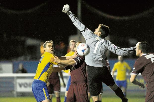 Echo: Concord goalscorer Tony Stokes watches as Chelmsford keeper Carl Pentney goes for the ball