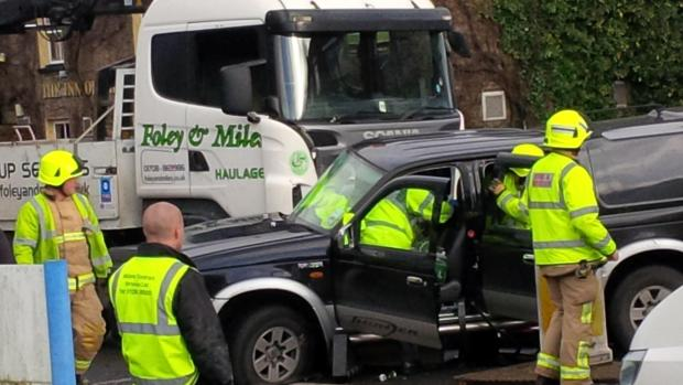 Woman cut free after lorry ploughs into 4x4