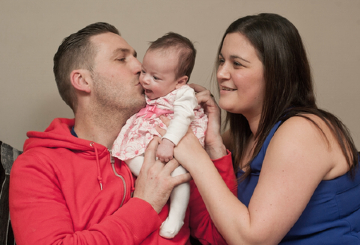 Happy moments – Christopher and Amanda Ott with their baby Amelia
