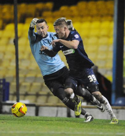 Lee Barnard in action for Blues on the difficult pitch