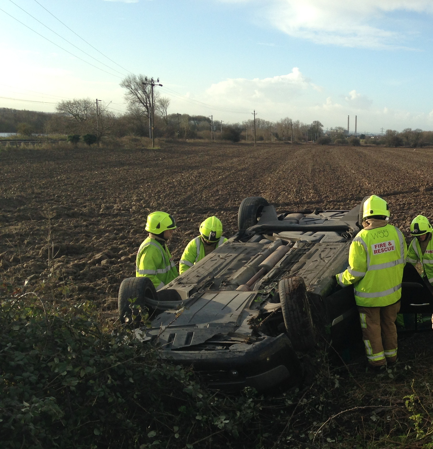 Woman cut free after car overturns
