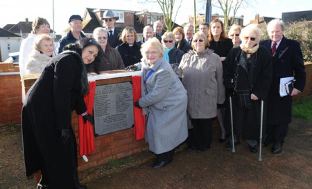 Ceremony – Castle Point mayor Maryse Iles and town council chairman Doreen Anderson unveil the plaque, inset, watched by victims' relatives, fellow councillors and MP Rebecca Harris