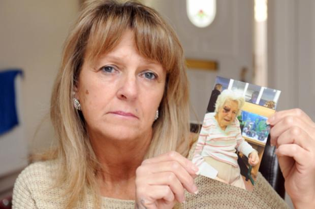 Upset – Shirley Roome holds up a picture of her mum who suffered injuries after falling from her bed at Beech House care home