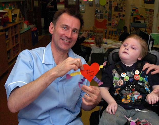 Jeremy Hunt and patient Callum Miller, 8, on the children's ward