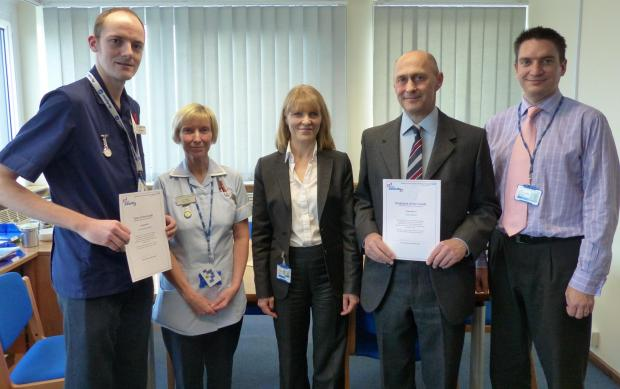 Recognition – hospital chief executive Clare Panniker, centre, flanked on the left by Mark Pinckney, and Kim Piper from Linford Ward, and on the right by senior perfusionist Scott Melvin and deputy chief executive Adam Sewell-Jones