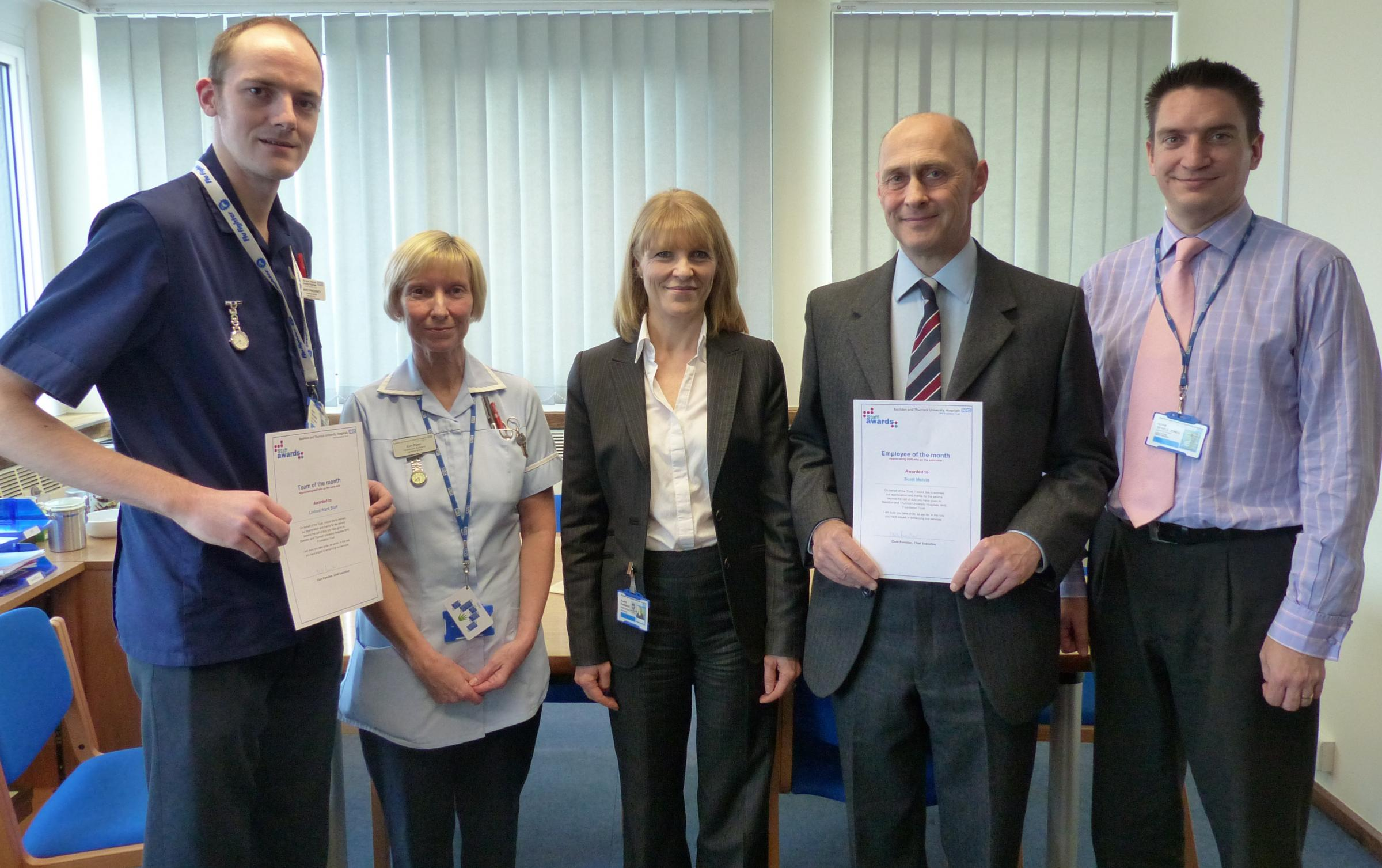 Recognition – hospital chief executive Clare Panniker, centre, flanked on the left by Mark Pinckney, and Kim Piper from Linford Ward, and on the right by senior perfusionis