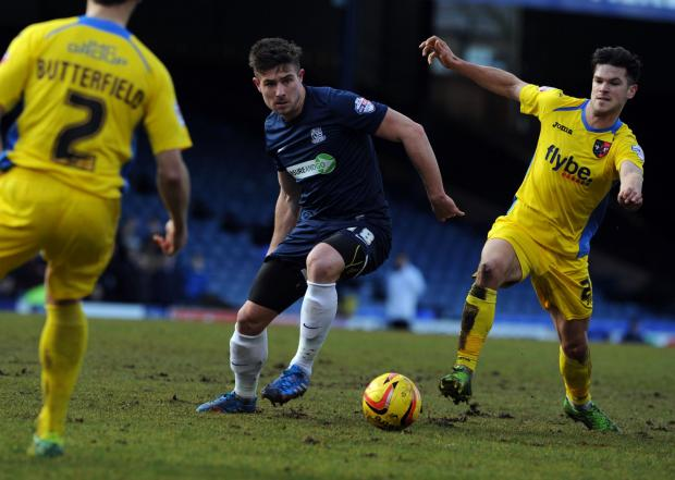 Ryan Leonard battles for the ball against Exeter City