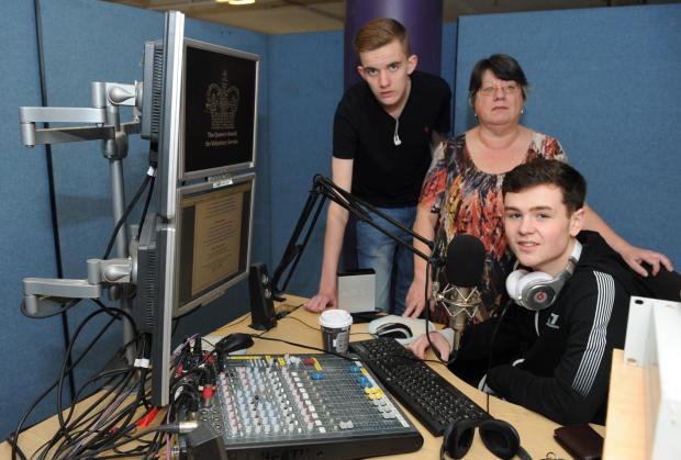 Still on air – receptionist Chris Tiernan with presenter Tom Berry and sports presenter Iain Quarman in Gateway FM's temporary studio in the Galleries at the Eastgate Centre, Basildon