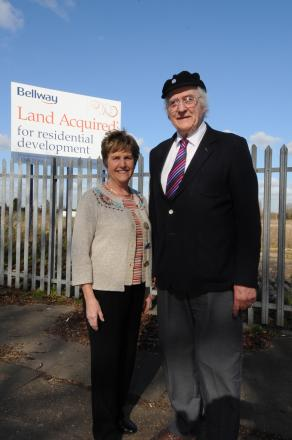 Great news - green belt campaigners Sally Edwards, and Mike King outside site where new hospice will be built