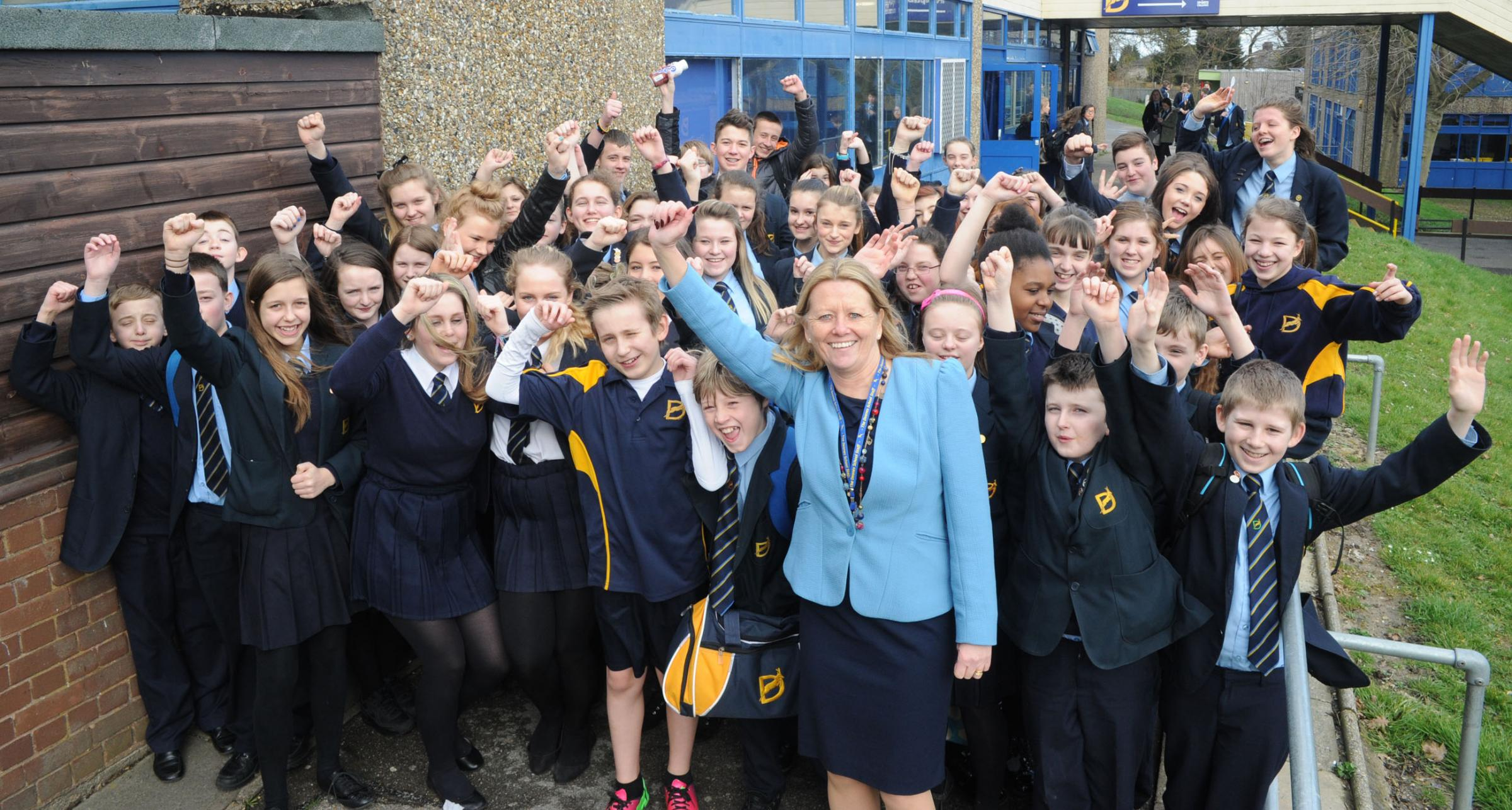Celebrations! Headteacher Jan Atkinson with happy children at the Deanes School