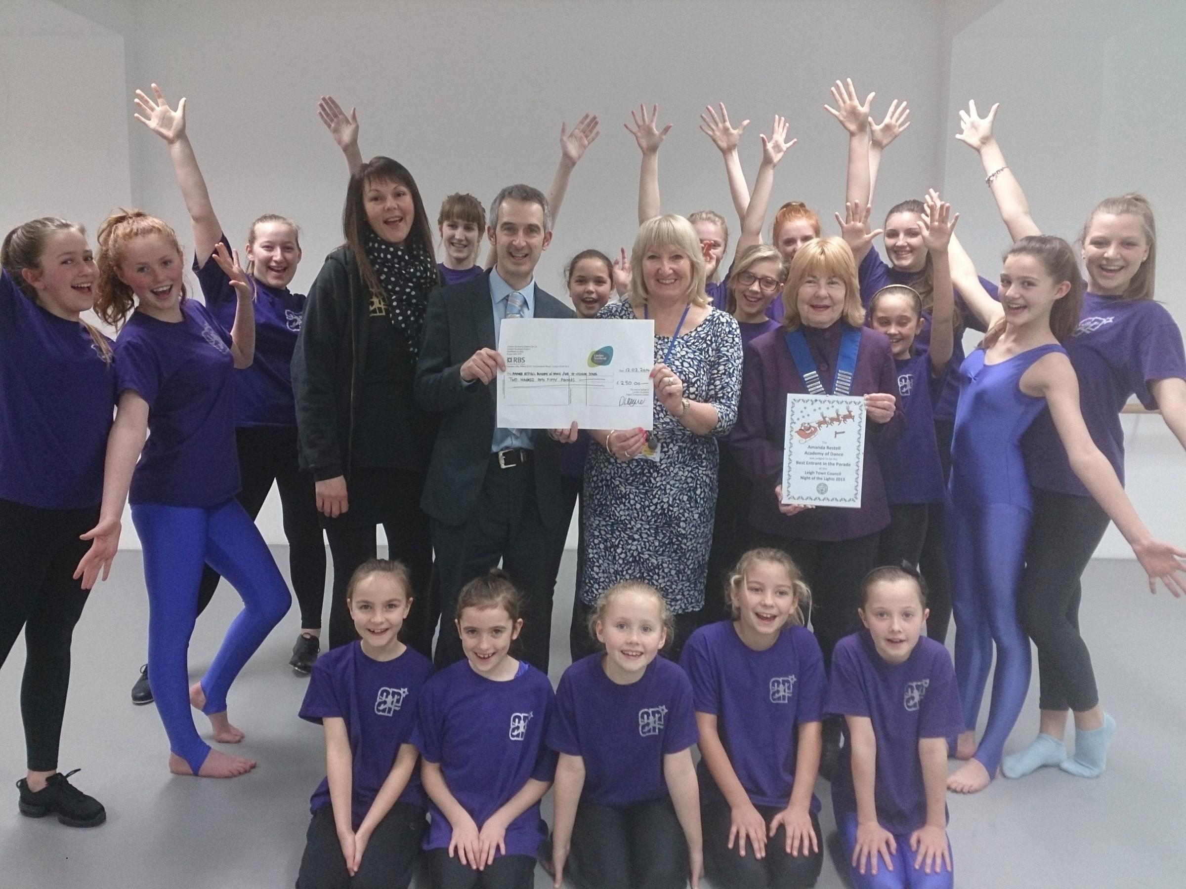 Winners – dancers receive their cheque from Paul Haynes