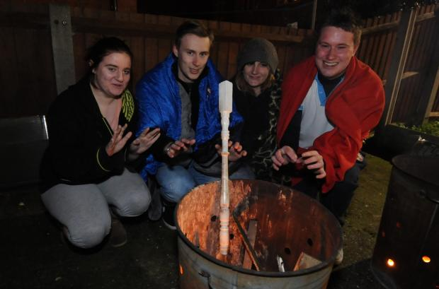Braving the cold – Louise Fisher, 17, George Underwood, 21, Millie Elsdon-James, 19, and Daniel Ford, 19, keeping warm at the Sleep Easy event