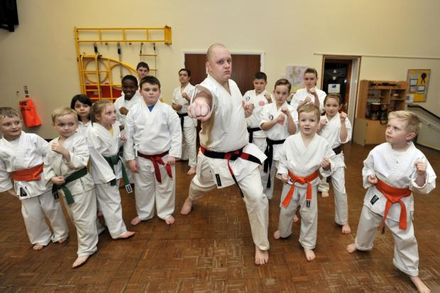 Celebrating - Instructor Marc Grayston puts another class of youngsters through their paces