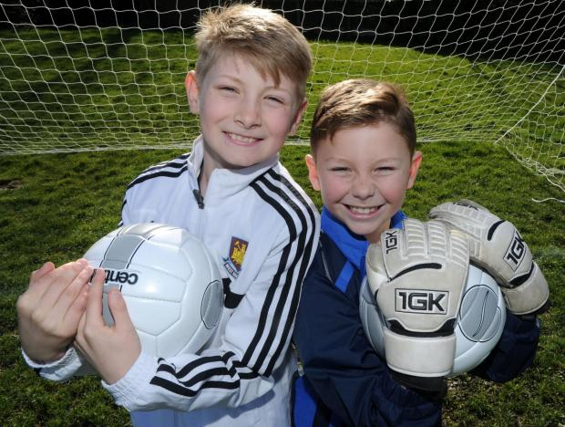 Football pals sign for big name rival clubs