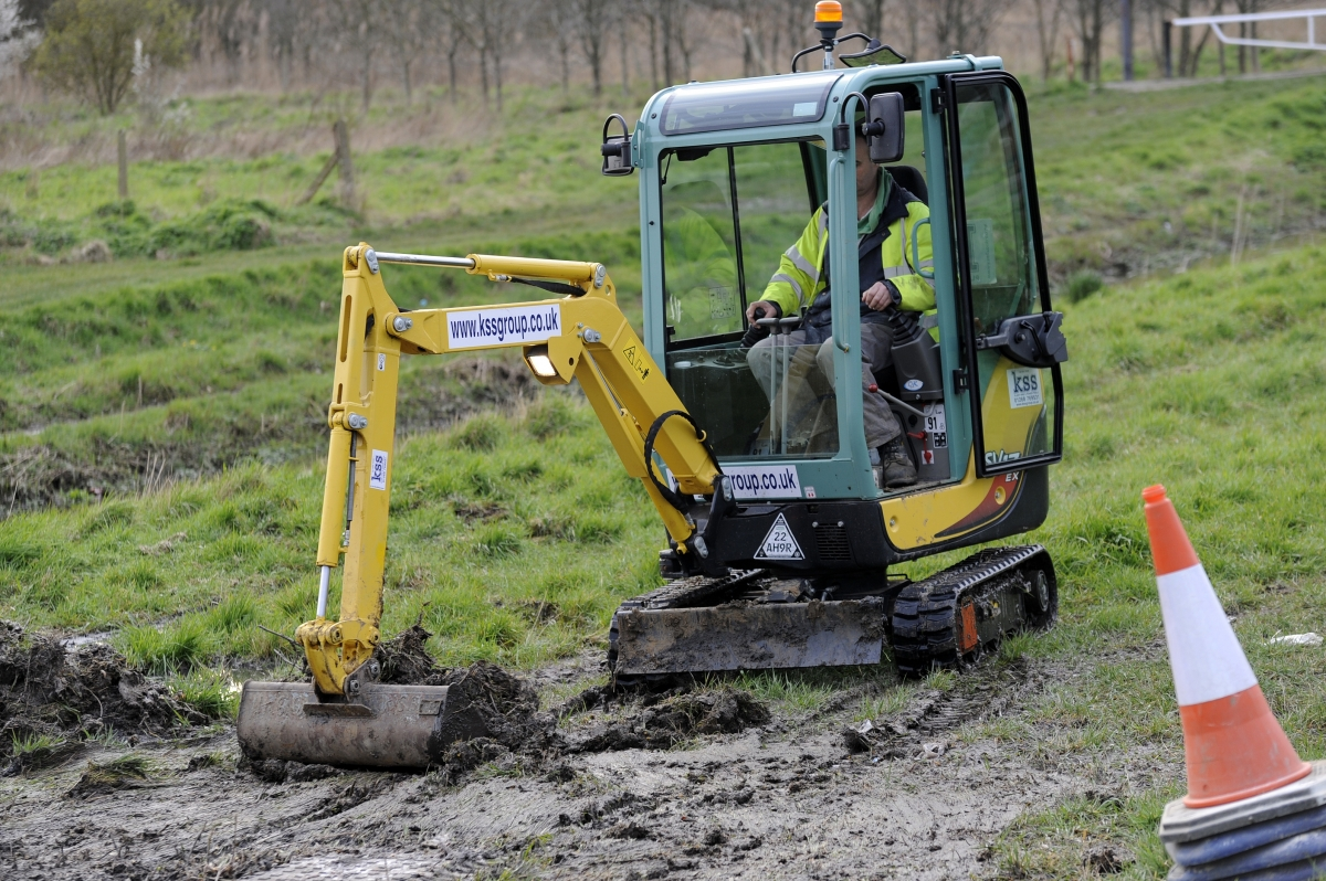 Digger clearing up the sewage in Richmond Park