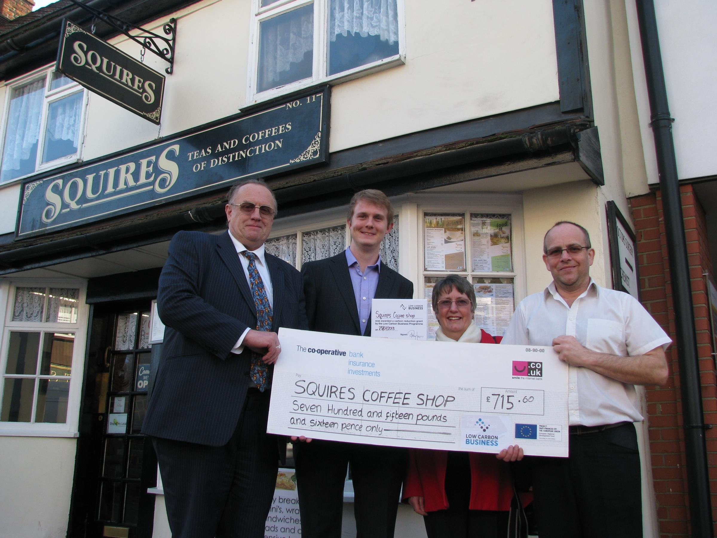 Green cheque – councillor Mike Steptoe with Sebastian Coombs and Stephanie Corder from Low Carbon Business, and Squires boss Carl Watson