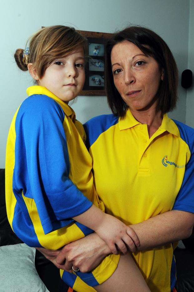 Echo: Borrowed clothes – Dee Harrison and five-year-old daughter, Gabriella in the Legacy Leisure shirts they had to wear home from the pool