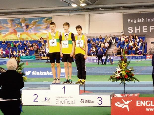 Robert Runciman, left, next to team-mate Thomas Hewes on the podium in Sheffield