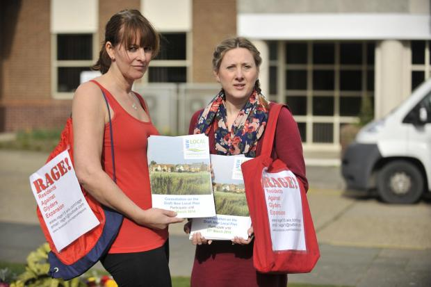 Echo: Do it yourself – Karen Robinson, left, and Jo Hannah pick up leaflets at the council offices