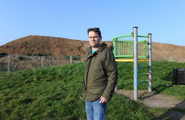 Huge mound – Andrew Buxton stands in front of the earth mountain in Gloucester Park
