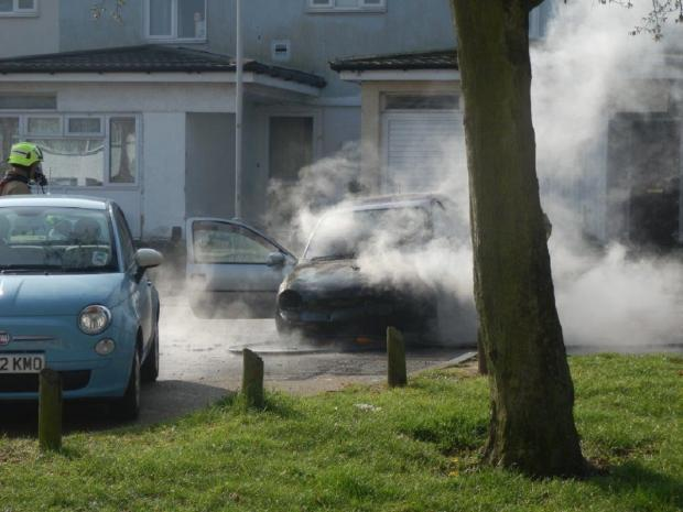 Man pushes blazing car away from homes