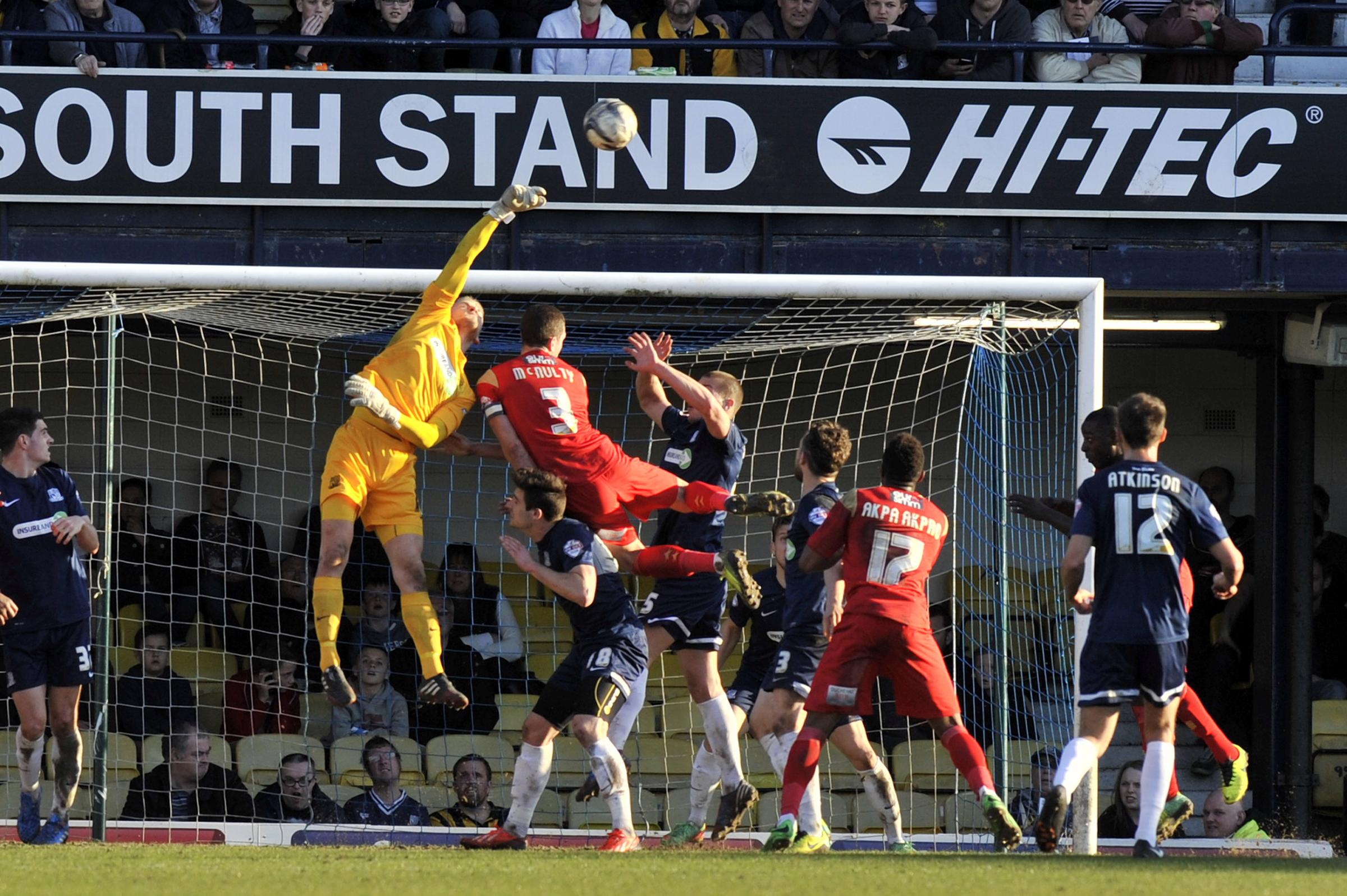 Punching clear - Daniel Bentley clears the ball for Southend United