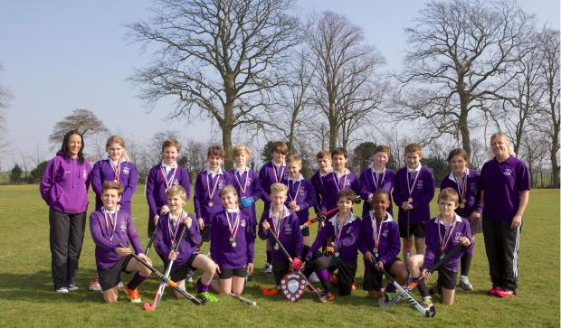 Purple patch — the hockey teams from Thorpe Hall with coaches Hayley Middleton and Kirsty Durban
