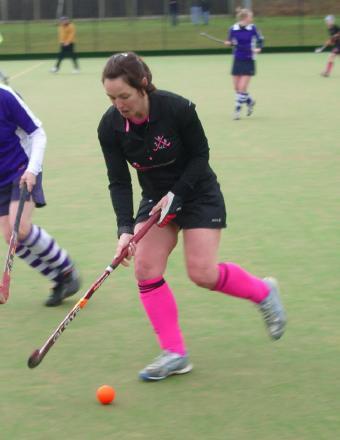 Adele Cole in action for Southend & Benfleet Ladies Hockey Club