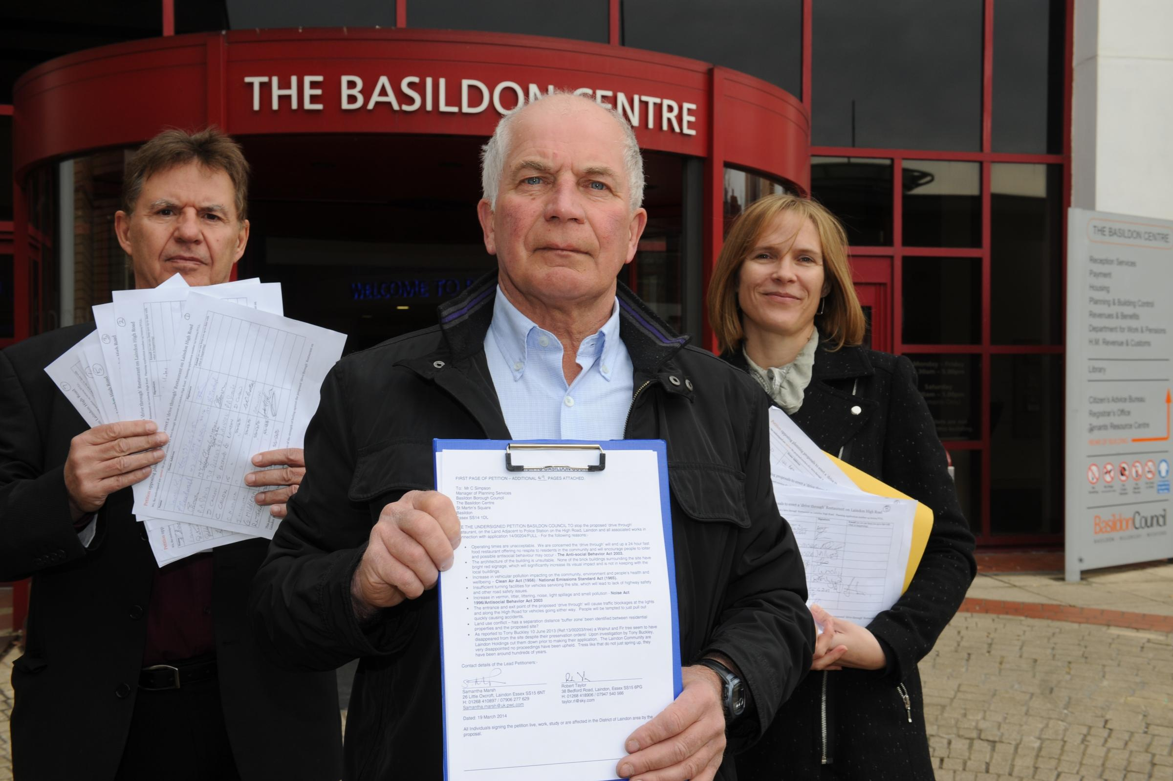 Protesters – John Scarola, Bob Taylor and Samantha Marsh with their petition