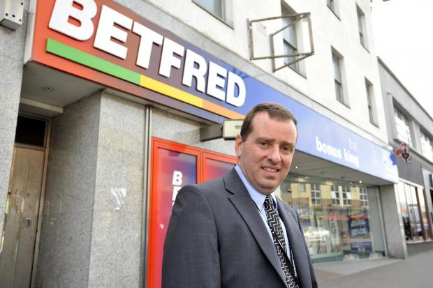 Councillor Jonathan Garston, outside Betfred, in London R