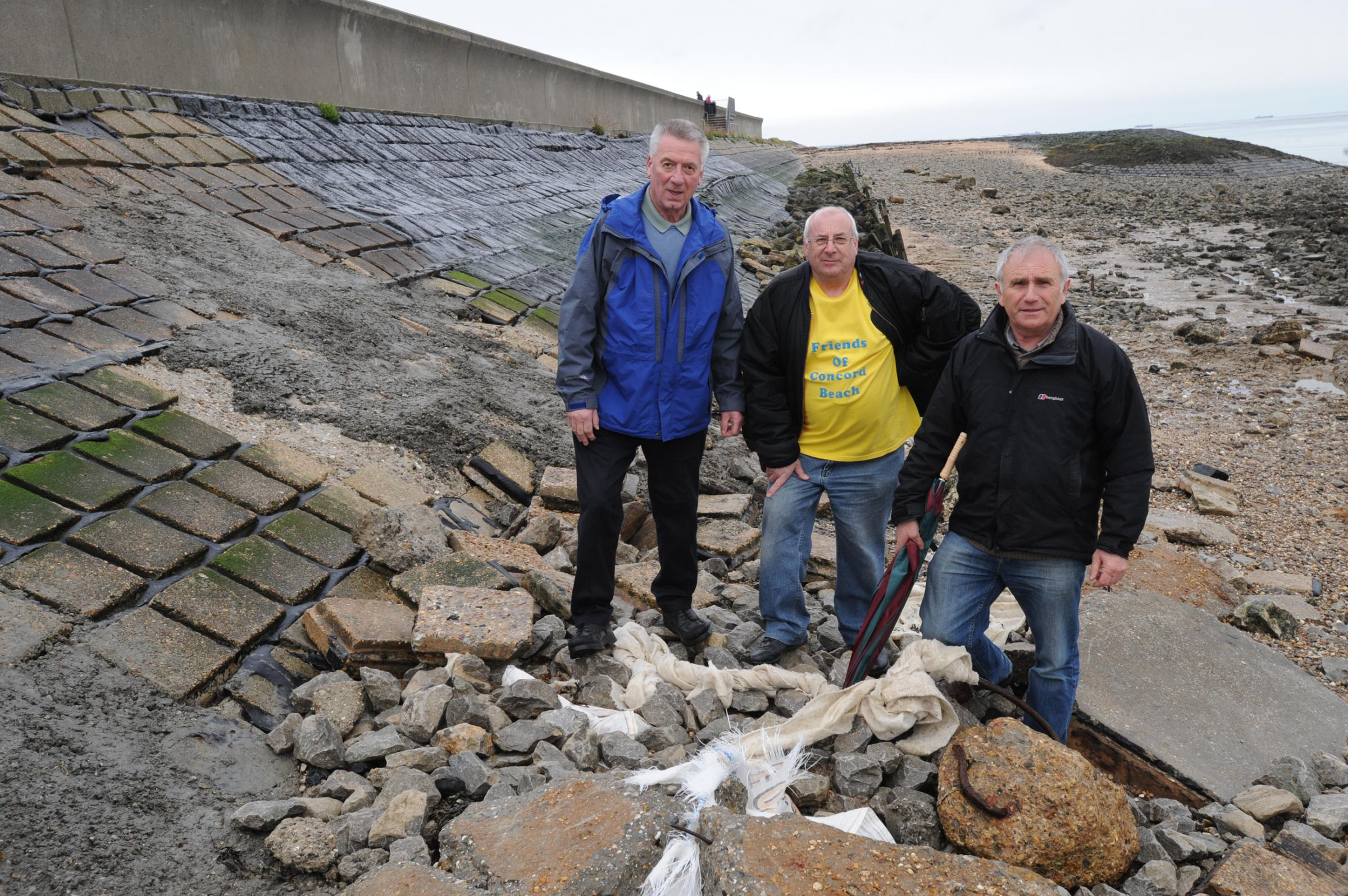 Not happy – town councillors Alan Aycott, Barry Palmer and Dave Blackwell, at the seawall