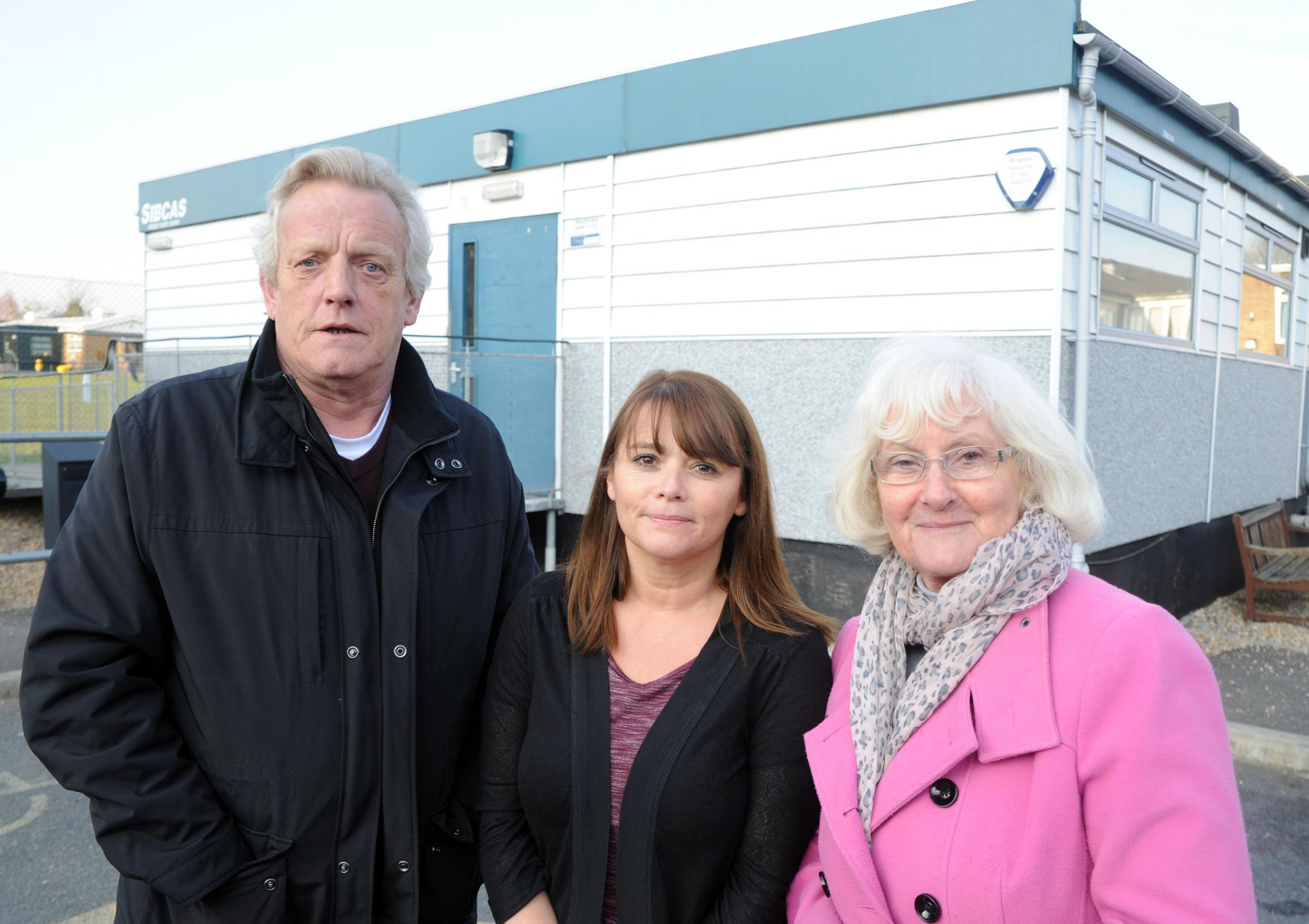 practice manager Lorna Salmon flanked by councillors Paul van Looy and Sally Carr outside the