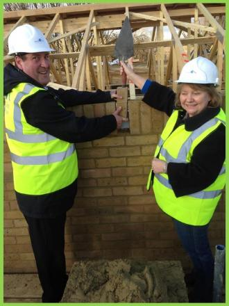 Helping hand – Chris Cox and Eileen Marshall put a brick in place