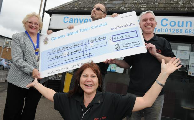 Congratulations – Doreen Anderson, left, presents the grant cheque to Trudy Britnell, Rob Simmons and David Revell-Smith