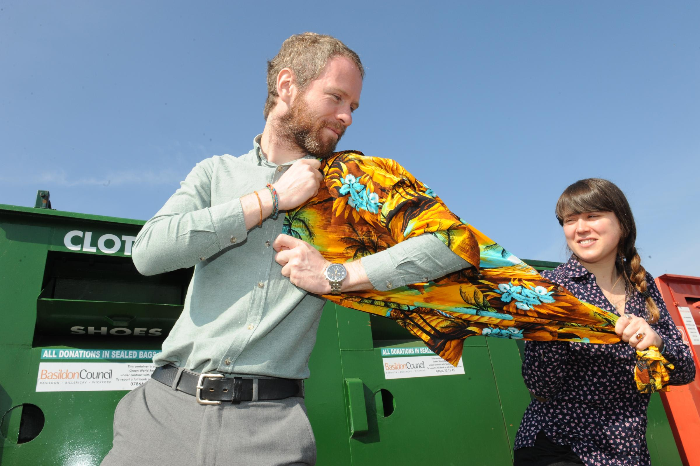 Getting shirty – recycling officer Courtney Groves tries to wrestle a dodgy shirt from colleague James Hendry
